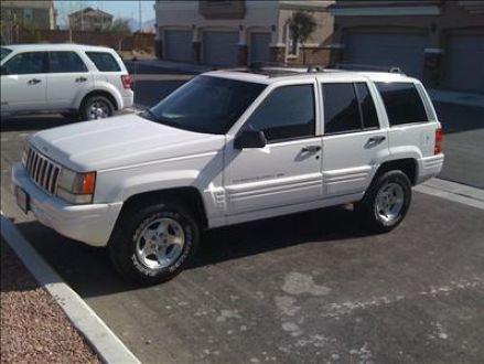 Excellent condition white 1998 jeep grand cherokee laredo for 1998 jeep grand cherokee master window switch